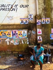 Lady cooking dinner under election posters
