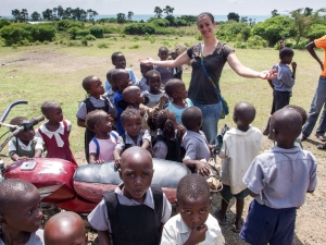 White lady comes to save African children from themselves by having her photo taken with them.